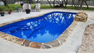 DC Pools by Design, Barrier Reef pool with flagstone coping