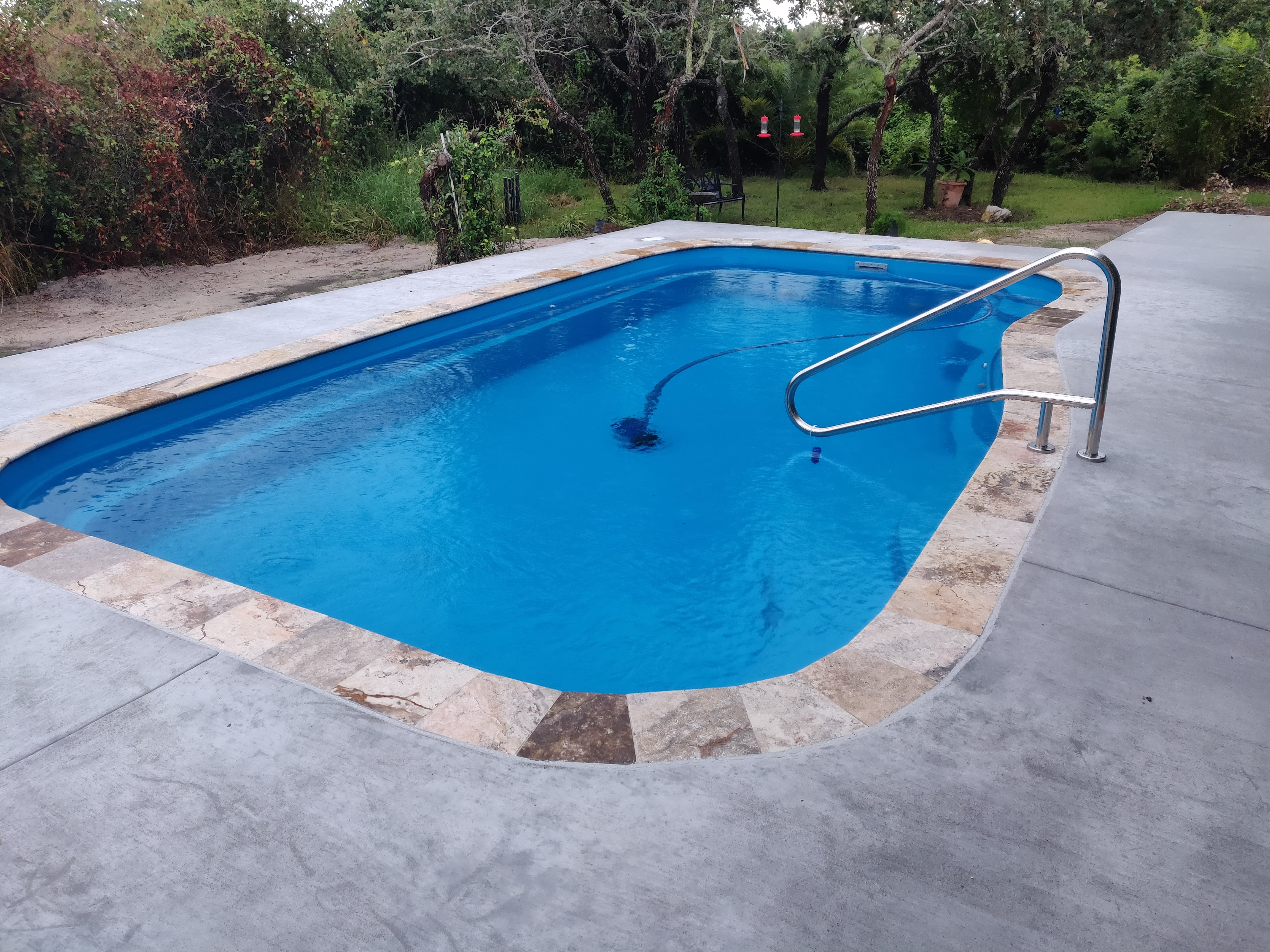 Fiberglass residential pool installed by Pools by DC Design.