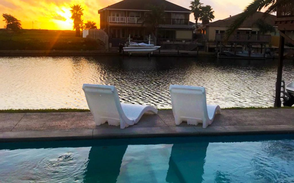 ICF swimming pool built by Pools by DC Design at sunset overlooking inlet in Corpus Christi, TX